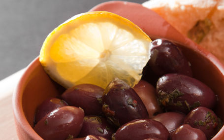 Red marinated olives with herbs