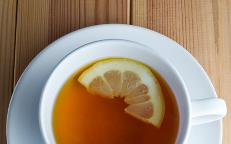 Lemon tea in a white cup